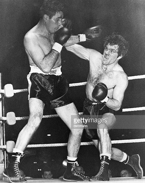 Cleveland's Joey Maxim wards off the right arm of Britain's Freddie Mills during their light heavyweight title fight at Earl's Court Maxim knocked...