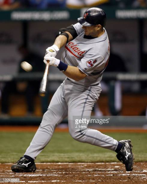 Cleveland's Travis Hafner connects on this pitch for a two run homerun during Friday night's game against Tampa Bay at Tropicana Field in St...