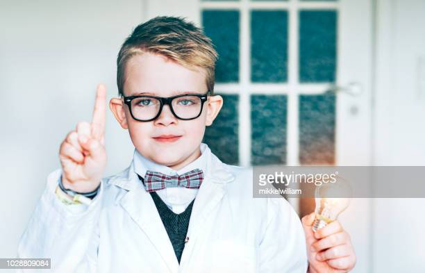 Clever child gets one idea at makes a hand sign