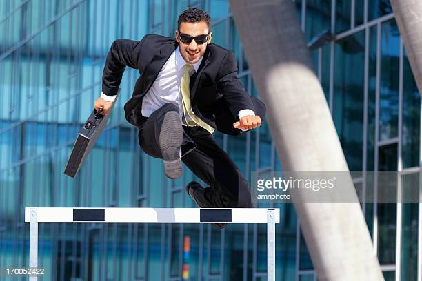 clever dynamic business hurdler - hurdling stock photos and pictures