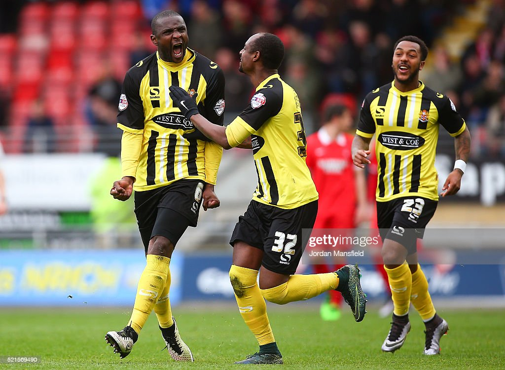 Clevid Dikamona of Dagenham & Redbridge celebrates scoring his side's second goal during the Sky Bet League Two match between Leyton Orient and Dagenham & Redbridge at Brisbane Road on April 16, 2016 in London, England.