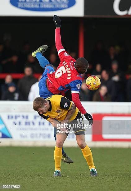 Clevid Dikamona of Dagenham Redbridge contests the ball with James Collins of Northampton Town during the Sky Bet League Two match between Dagenham...