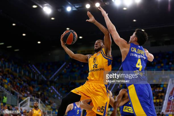 Clevin Hannah #5 of Herbalife Gran Canaria competes with Angelo Caloiaro #4 of Maccabi Fox Tel Aviv during the 2018/2019 Turkish Airlines EuroLeague...