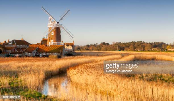 cley windmill in the sun - old windmill stock photos and pictures