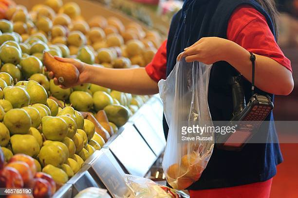 Click and Collect shopper getting an order ready selects fruit Loblaws on Monday released more detail about how it plans to spend $12billion on...