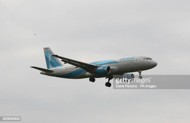 A Clickair Airbus A320 plane lands at Heathrow Airport in MiddleseX
