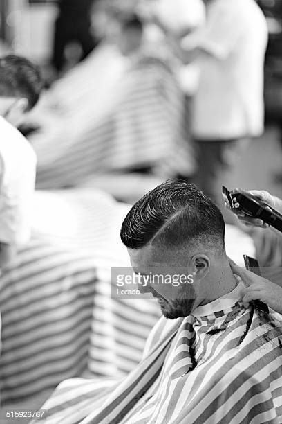 client at barbershop getting trimmed