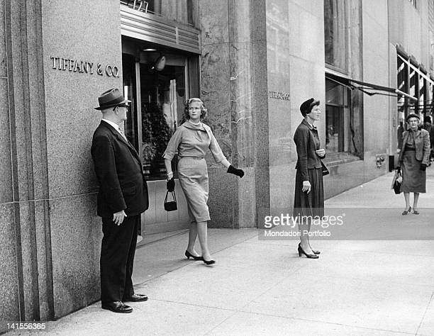 A client coming out of the Tiffany jewellery on Fifth Avenue New York November 1960
