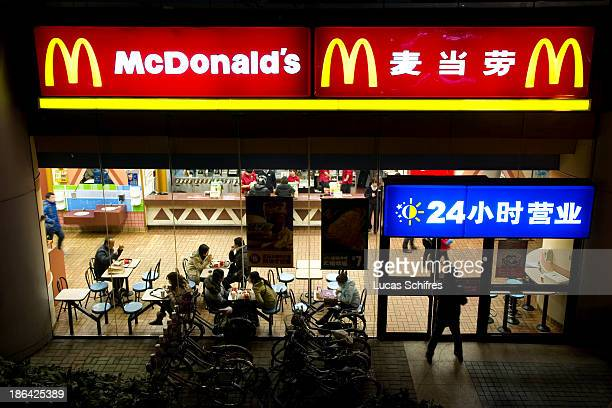 A client enters a McDonald's fast food restaurant at night in Shanghai China on February 18 2011