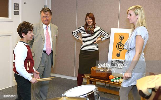 Client 'Erenik' Chairman of PPL Fran Nevekla music therapist Claire Hope and musician Alison Balsom during a visit to the Nordoff Robbins Music...