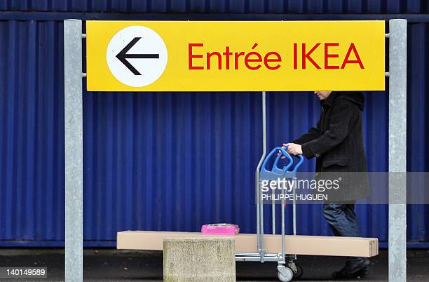 A client gets in an Ikea store on February 29 2012 in Lomme northern France Weekly French newspaper Le Canard Enchaine and investigative website...