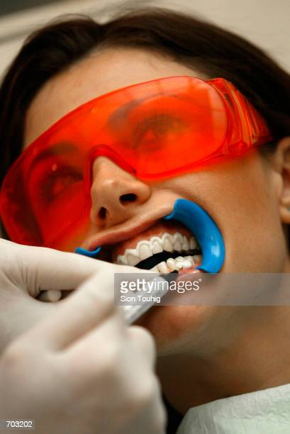 A client has her teeth whitened with light activated bleach February 27 2002 at the launch of smilestudio'' in London the UKs first dedicated teeth...