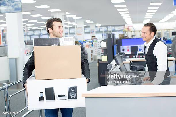 client is happy with his new products - electronics store stock photos and pictures