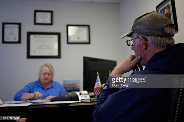 A client listens as accountant Gina Chaney prepares his federal income tax returns at Tax Pros USA in La Grange Kentucky US on Wednesday April 9 2014...