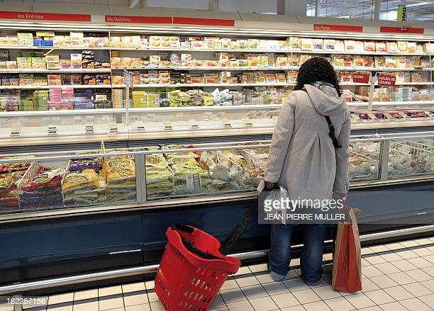 A client looks at products displayed at the frozen products area of a supermarket in Bordeaux on February 21 2013 A Europewide food fraud scandal...