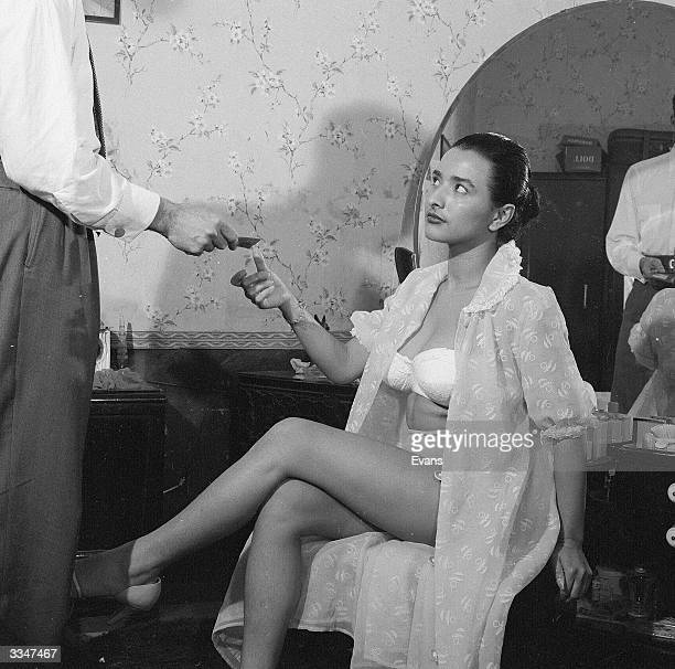 A client paying a prostitute at a brothel in Guatemala City capital of Guatemala