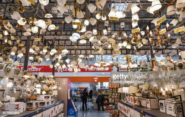 Clients are pictured inside a household appliance store in Bucharest Romania on February 9 2018 Romania has record economic growth the highest in the...