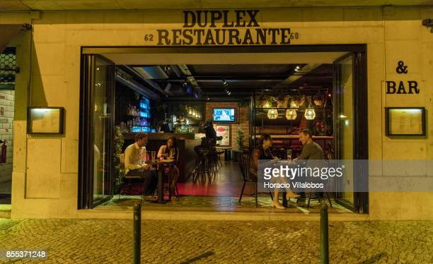Clients are seen at Duplex restaurant in Cais do Sodre neighborhood on September 27 2017 in Lisbon Portugal Historic neighborhoods in Lisbon attract...