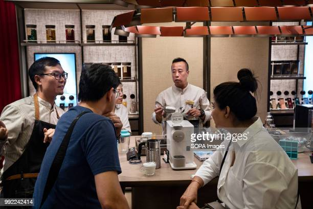 Clients at the Swiss highend and world leader in coffee capsules brand Nespresso store at Hong Kong's ifc shopping mall in Central district