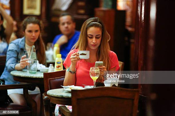 Clients enjoy a cup of coffee at Cafe Tortoni on January 14 2015 in Buenos Aires Argentina Cafe Tortoni was founded in 1858 by Jean Touan a French...