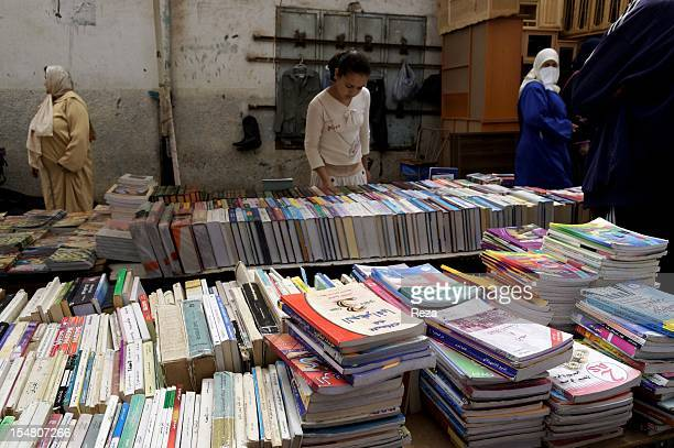 Clients in front of a book stand in the Madina Jadida market on April 9 in Oran Algeria