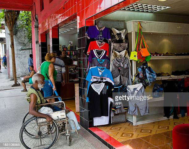 Clients look for clothes in a privatelyowned shop in Havana on October 4 2013 Cuban Labor Vice Minister Marta Elena Feito said Tuesday that the...