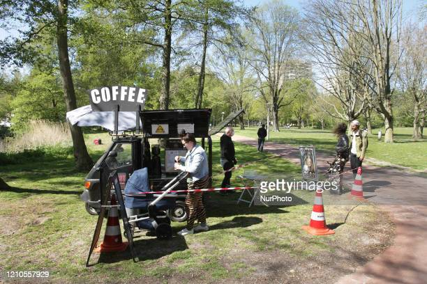 Clients of a coffee vendor observe social distancing at the Rembrandt Park on April 20 2020 in AmsterdamNetherlands Dutch Prime Minister Mark Rutte...