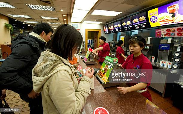 Clients order food at a McDonald's fast food restaurant in Shanghai China on February 18 2011