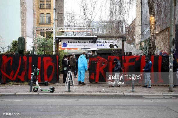 Clients queue for a Covid-19 test outside the Kit Kat club which is functioning as a temporary coronavirus testing station in Berlin, Germany, on...