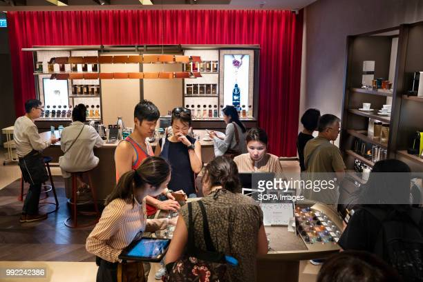 Clients wait in line at the Swiss highend and world leader in coffee capsules brand Nespresso store at Hong Kong's ifc shopping mall in Central...
