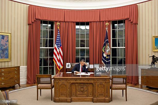 CLIENTSThis official White House photograph made available May 2, 2011 shows US President Barack Obama editing his remarks in the Oval Office prior...