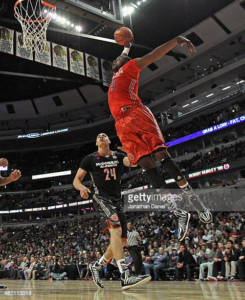Cliff Alexander of the East team goes up for a dunk over Reid Travis of the West team during the 2014 McDonald's All American Game at United Center...