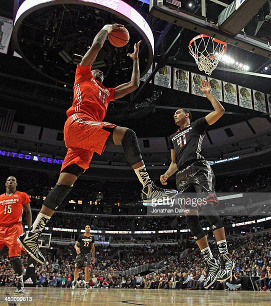Cliff Alexander of the east team rebounds over Trey Lyles of the west team during the 2014 McDonald's All American Game at United Center on April 2...