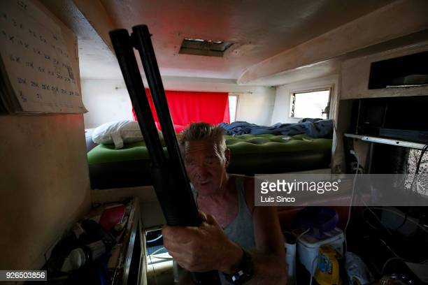 Cliff Allen checks the condition of a shotgun that he kept inside his recreational vehicle Allen lived for eight years in Machester Square a former...
