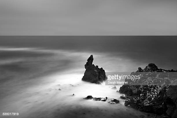 cliff and big rock on the sea - cap d'agde stock photos and pictures