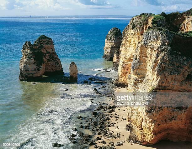 Cliff and rocks on the coast between Ponta da Piedade and Ponta d' Ana Algarve Portugal