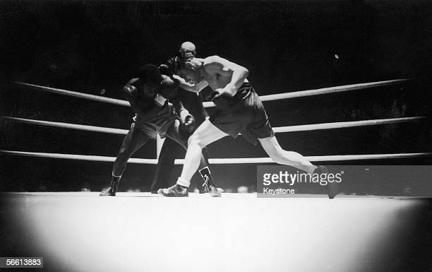 Cliff Anderson the featherweight champion of British Guiana defends himself against England's Hal Bagwell during a fight at the Albert Hall in London...