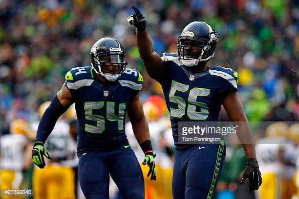 Cliff Avril and Bobby Wagner of the Seattle Seahawks celebrate against the Green Bay Packers during the 2015 NFC Championship game at CenturyLink...