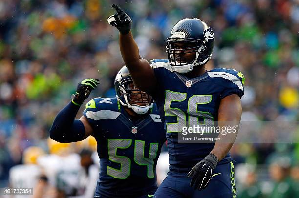 Cliff Avril and Bobby Wagner of the Seattle Seahawks react during the third quarter of the 2015 NFC Championship game against the Green Bay Packers...