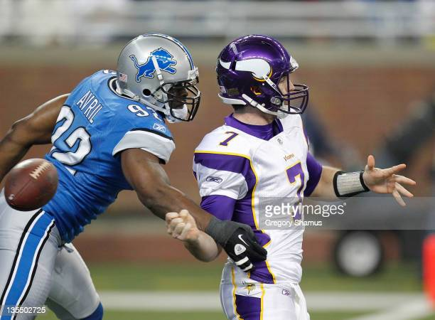 Cliff Avril of the Detroit Lions causes a first quarter fumble against Christian Ponder of the Minnesota Vikings that ended up being recovered in the...