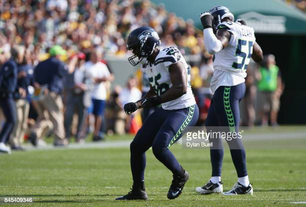 Cliff Avril of the Seattle Seahawks celebrates after sacking Aaron Rodgers of the Green Bay Packers during the first half at Lambeau Field on...