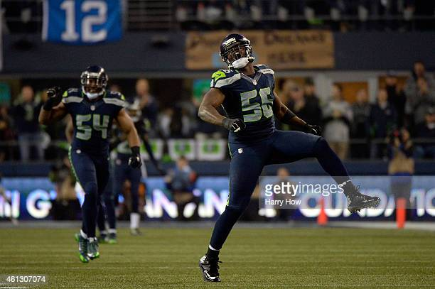 Cliff Avril of the Seattle Seahawks celebrates sacking Cam Newton of the Carolina Panthers in the third quarter during the 2015 NFC Divisional...