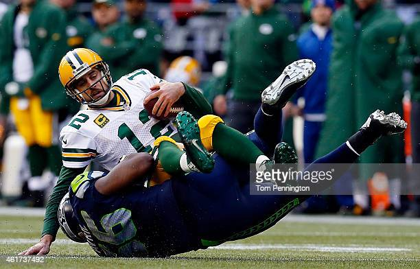 Cliff Avril of the Seattle Seahawks sacks Aaron Rodgers of the Green Bay Packers during the third quarter of the 2015 NFC Championship game against...
