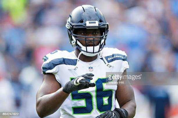 Cliff Avril of the Seattle Seahawks signals to the sidelines during a game against the Tennessee Titans at Nissan Stadium on September 24 2017 in...