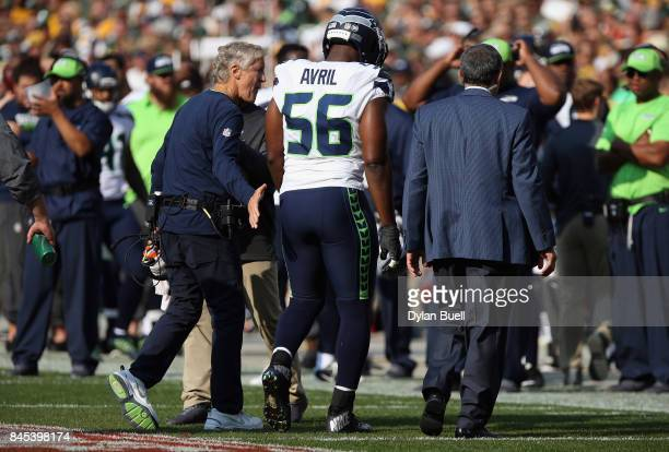Cliff Avril of the Seattle Seahawks walks off the field after suffering an apparent injury during the first half against the Green Bay Packers at...