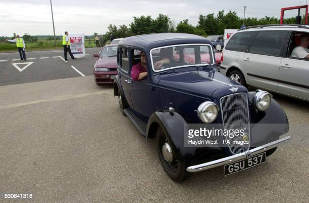Cliff Ball in his 1937 Austin Cambridge queues for tax free fuel at a Murco service station in Deanshanger near Milton Keynes Buckinghamshire which...