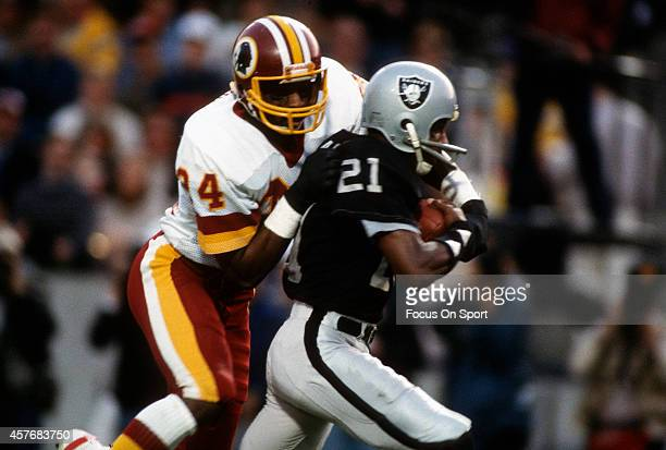 Cliff Branch of the Los Angeles Raiders catches a pass while defended by Anthony Washington of the Washington Redskins during Super Bowl XVIII on...