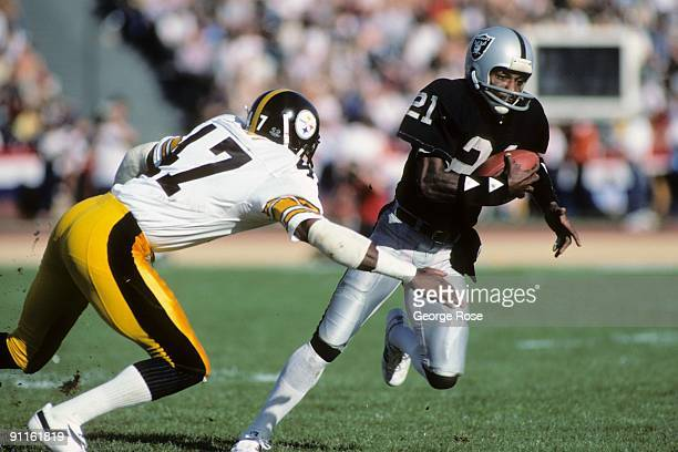 Cliff Branch of the Los Angeles Raiders runs the ball against Mel Blount of the Pittsburgh Steelers during the AFC Divisional playoff game at the Los...