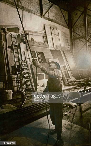 APR 19 1972 APR 22 1972 Cliff Brown Guides Ropes Carrying an IBeam to workers Ibeams installed in 1932 at height of 32 feet were being raised to...