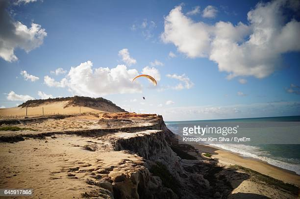 cliff by sea against sky - natal brazil stock pictures, royalty-free photos & images